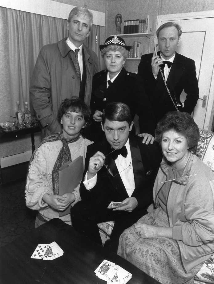 "The Cast Standing, left to right: Stewart Hiorns (""Morgan""), Julie Greenwood (""Hughes""), Tim Weldon (""Jeffrey""). Sitting, left to right: Donna McOnie (""Sally""), David McOnie (""Gus""), Doreen Davies (""Ronnie"")."