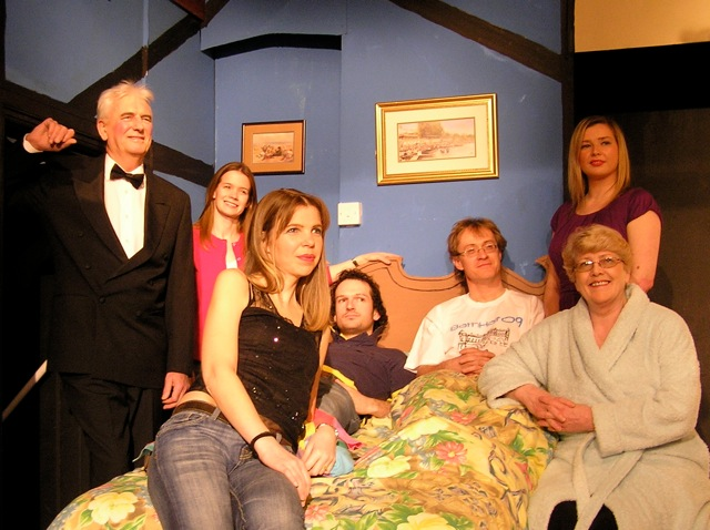 "The Cast (-1). Left to right: Stewart Hiorns (""Ernest""), Helen Gwiliam (""Kate""), Piers Morgan Harvey (""Trevor""), Sian Cole (""Susannah""), Roger Bell (""Nick""), Julie Greenwood (front) (""Delia""), Laura Sims (back) (""Jan"")"