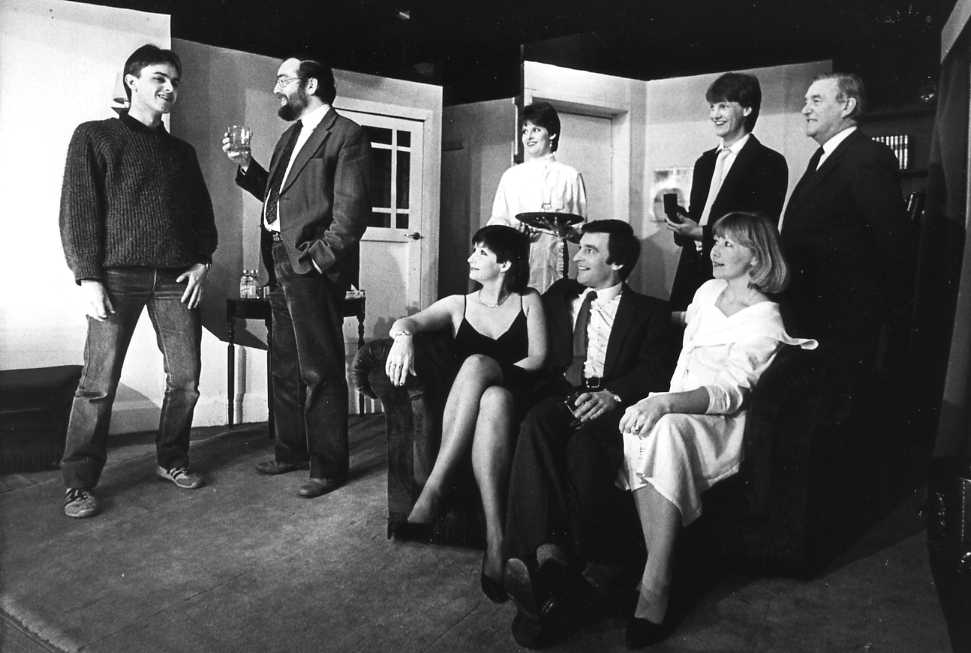 "The Cast Left to right: Andrew Evason (""Gavin""), David Spear (""Charles""), Maria Clee (""Nora""), Della Jukes (""Liz""), Barry Cooper (""Peter""), Ross James (""DS Bassett""), Jill Usher (""Mary""), Bill Riseborough (""DI Fowler"")"