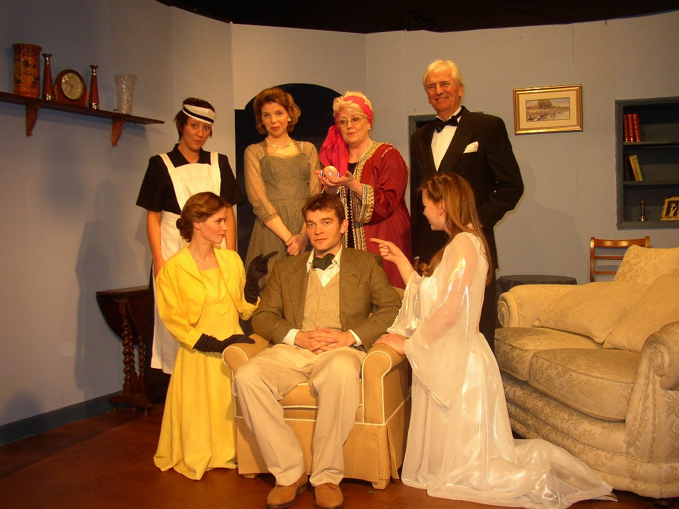 "The Cast & Set Standing, left to right: Sam Pullen (""Edith""), Sian Cole (""Mrs Bradman""), Julie Greenwood (""Mme Arcati""), Stewart Hiorns (""Dr Bradman""). Sitting, left to right: Helen Gallagher (""Ruth""), Jaimes Cooper (""Charles""), Laura Sims (""Elvira"")."