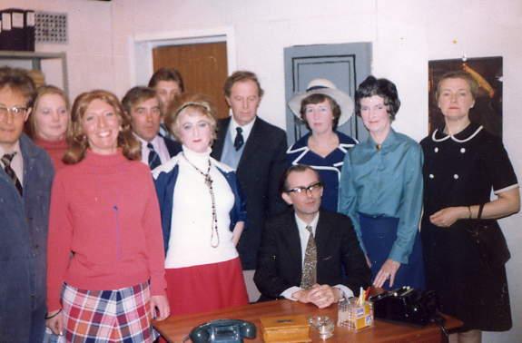 "Cast Members Left to right: Robert Williams (""photographer""), Janet Davies (""Doreen""), Brian Shaw (""George""), Margaret Lloyd (""Miss Harvey""), Sid West (""Phillip"")."