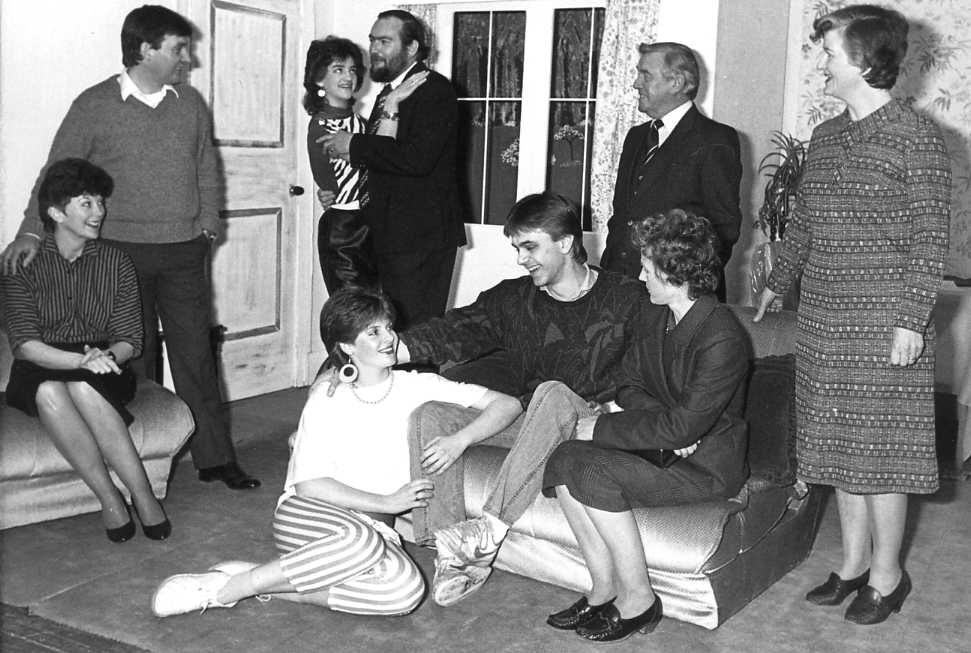 "The Cast Standing, left to right: Barry Cooper (""John""), Carol Shepherd (""Rita""), David Spear (""Mr Watson""), Bill Riseborough (""DCI Conway""), Brenda Jones (""Mrs Parks""). Sitting, left to right: Jackie Cooper (""Helen""), Maria Clee (""Susan""), Andrew Evason (""Michael""), Alison Shepherd (""Mary"")."