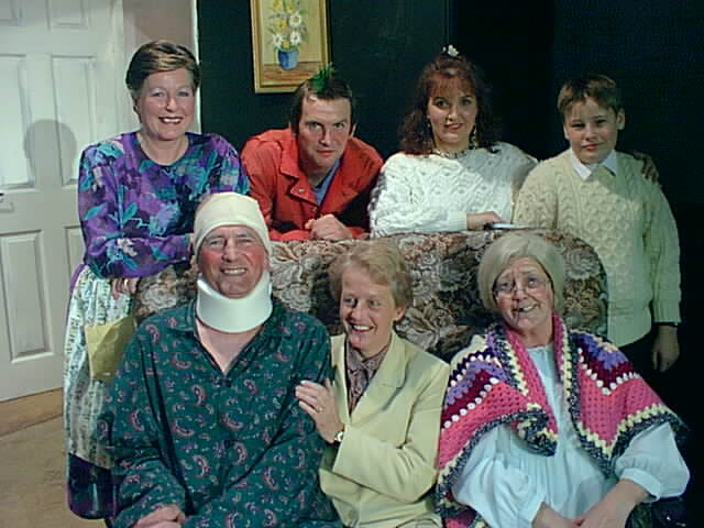 "The Cast Left to right, standing: Doreen Davies (""Maisie""), Ian Evans (""Bobby""), Clare Evans (""Tracy""), ? (""Jeffrey""). Left to right, sitting: Stewart Hiorns (""Idris""), Alison Shepherd (""Elsie""), Julie Greenwood (""Gran"")."