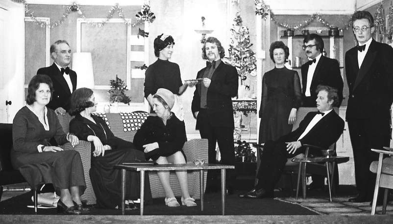 "The Cast Standing, left to right: Sid West (""Stephen""), Margaret Lloyd (""Annie""), Clive West (""Nicholas""), Brenda Jones (""Jacqueline""), Hugh Arnold (""Victor""), Brian Shaw (""Roger""). Sitting, left to right: Jacqueline Baskerville (""Pamela""), Dorothy Morris (""Ethel""), Patricia Quick (""Amelia""), Geoff Badham (""Henry"")."