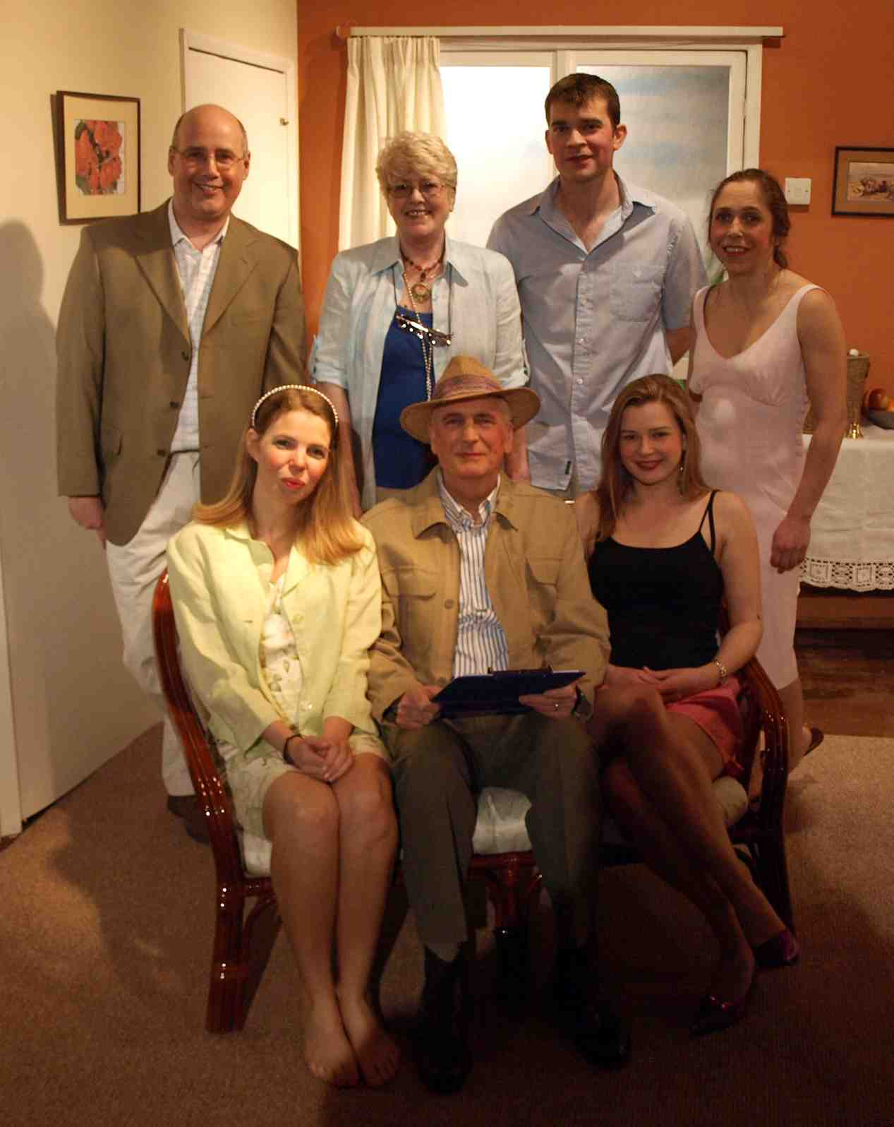 "Standing, left to right: Steve Nelson (""Perky""), Julie Greenwood (""Celia""), Jaimes Cooper (""Leslie""), Carol Rood (""Kit""). Seated, left to right: Sian Cole (""Mary""), Stewart Hiorns (""Chitto""), Laura Sims (""Eve"")."