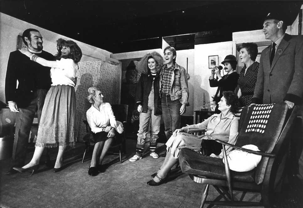 "The Cast & Set Left to right: David Spear (""Rev Humphrey""), Diane Clarke (""Josephine""), Margaret Lloyd (""Hariette""), Linzi John (""Pixie""), Andrew Evason (""Peter""), Felicity Harris (""Winifred""), Edward Jones (Photographer), Brenda Jones (""Mrs Carter""), Sid West (Postman)."