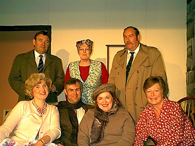"""The Cast Left to right, standing: Barry Cooper (""""visitor""""), Julie Greenwood (""""Mrs Small""""), David Spear (""""DS Bullock""""). Left to right, sitting: Heather Cooper (""""young woman""""), Tony Currell (""""George""""), Denise Currell (""""Jennifer""""), Doreen Davies (""""Esther"""")."""
