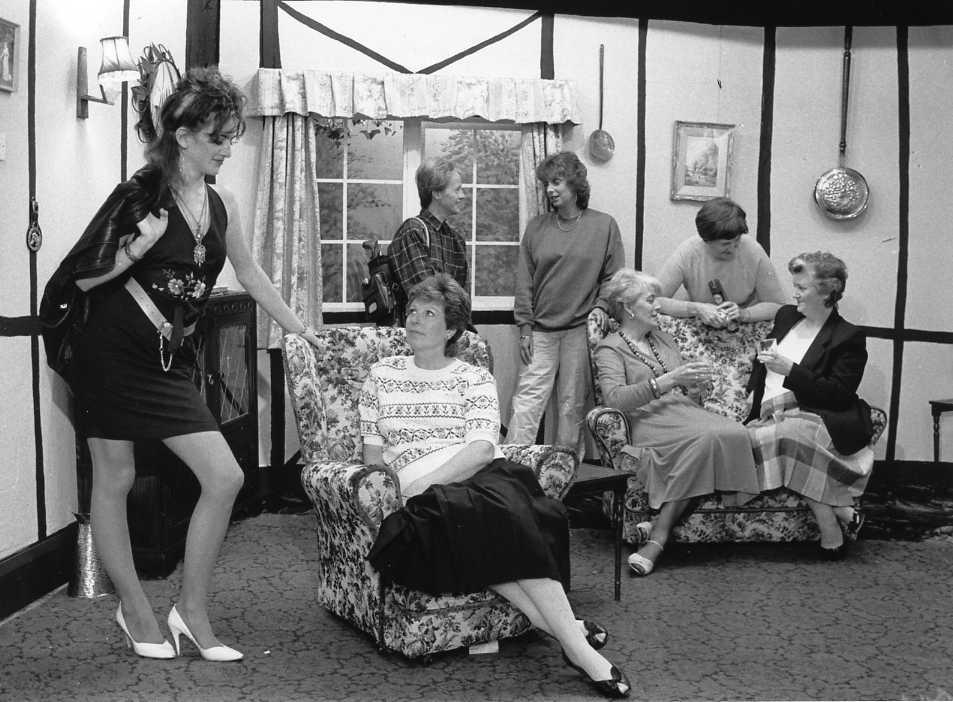 "The Cast & Set Left to right: Carol Shepherd (""Ruth""), Doreen Davies (""Leila""), Alison Shepherd (""Minnie""), Julia Bradley (""Trudi""), Anita McNamara (""Bridget""), Dorothy Morris (""Mrs Bolders""), Brenda Jones (""Beryl"")."