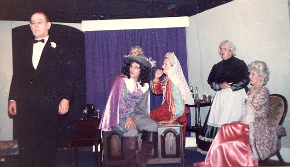 "Cast Members Left to right: Harry Maslin (""Sir Charles""), Barry Cooper (""Jimmy""), Dorothy Morris (""Miss Groze""), Beryl Maslin (""Miss Wragg""), Margaret Lloyd (""Mrs Arthur"")."