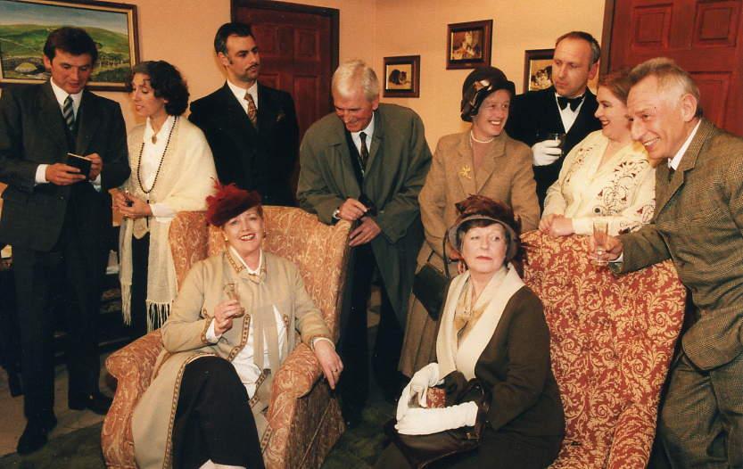 "The cast Seated, left to right: Julie Greenwood (""Elizabeth""), Doreen Davies (""Margaret""). Standing, left to right: Ian Evans (""Thomkins""), Judi Porter (""Mildred""), Tony Currell (""Marceau""), Stewart Hiorns (""Pratt""), Alison Shepherd (""Joan""), Tim Weldon (""Bunting""), Denise Currell (""Dorothy""), Tony Webb (""Craddock"")."