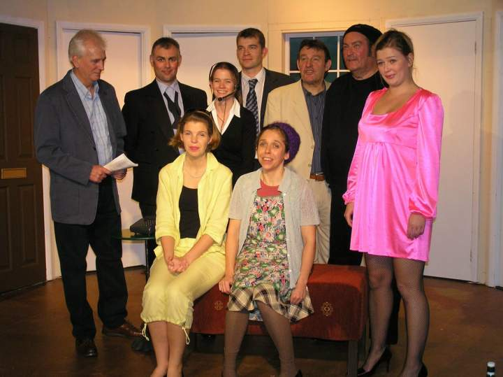 "The cast. Standing, left to right: Stewart Hiorns (""Lloyd""), Tony Currell (""Tim""), Helen Gwiliam (""Poppy""), Jaimes Cooper (""Gary""), Barry Cooper (""Frederick""), David Spear (""Selsdon""), Laura Sims (""Brooke""). Sitting, left to right: Sian Cole (""Belinda""), Carol Rood (""Dotty"")."