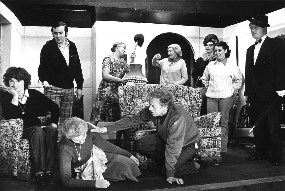 "The Cast & Set Left to right: Mair Morgan (""Miranda""), David Spear (""Nigel""), Margaret Lloyd (""Grandma""), Dorothy Morris (""Mrs Bunce""), Geoff Badham (""George""), Sandra Davies (""Amy""), Jackie Cooper (""Mrs H-P""), Carol Fowler (""Jackie""), Brian Shaw (""Horace"")."
