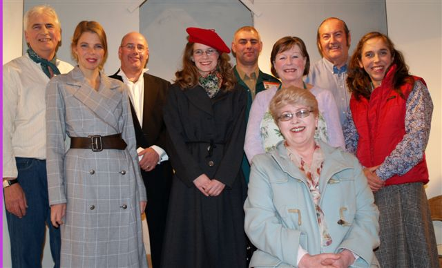 "The Cast. Left to right, standing: Stewart Hiorns (""Lawrence""), Sian Cole (""Olivia""), Steve Nelson (""Noel""), Helen Gwiliam (""Antonia"" & ""Penny""), Tony Currell (""Richard"" & ""Danus""), Doreen Davies (""Ellen""), David Spear (""George""), Carol Rood (""Nancy""). Seated: Julie Greenwood (""Penelope"")."