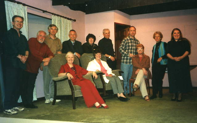 "Members of the Cast & Crew Sitting, left to right: Dorothy Morris (director), Doreen Davies (""Christine""), Julie Greenwood (props). Standing, left to right: Simon Ellett (set), Geoff Davies (front-of-house), Alan Bailey (stage manager), Tony Webb (""George""), Sue Harvey (""Susan""), Stewart Hiorns (""Peter""), Tim Weldon (""Ian""), Alison Shepherd (prompt), Denise Currell (""Ruth"")."