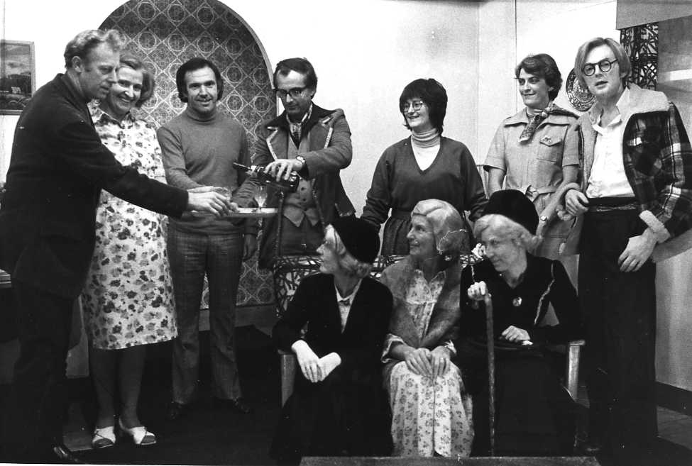 "The Cast Standing, left to right: Geoff Badham (""Walter""), Dorothy Morris (""Ethel""), Alan Booker (""Frank""), Brian Keal (""Harry""), Brenda Jones (""Alison""), Anita McNamara (""Peggy""), Gwyn Roberts (""Melvyn""). Sitting, left to right: Carol Fowler (""Honoria""), Margaret Lloyd (""Priscilla""), Mair Morgan (""Matilda"")."