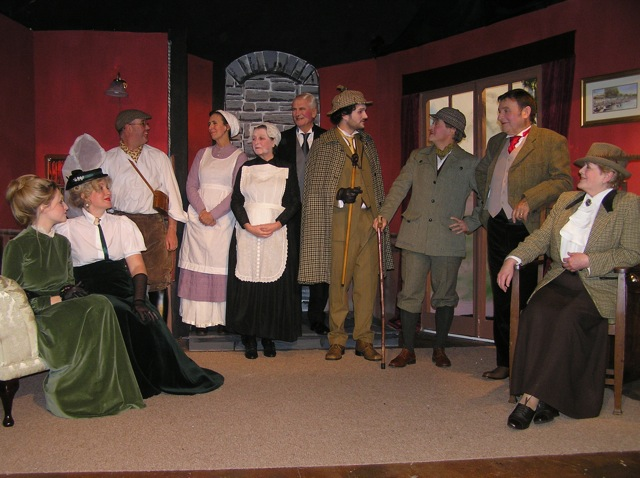 "The Cast. Left to right:  Sarah Govier (""Laura""), Heather Cooper (""Kathy""), Steve Nelson (""Jack""), Judi Porter (""Perkins""), Doreen Davies (""Mrs Barrymore""), Stewart Hiorns (""Barrymore""), Piers Morgan Harvey (""Holmes""), Roger Bell (""Watson""), Barry Cooper (""Sir Henry""), Julie Greenwood (""Lady Agatha"")."