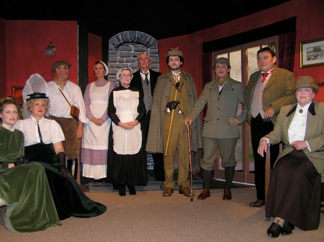 "The Cast. Left to right:  Sarah Govier (""Laura""), Heather Cooper (""Kathy""), Steve Nelson (""Jack""), Judi Porter (""Perkins""), Doreen Davies (""Mrs Barrymore""), Stewart Hiorns (""Barrymore""), Piers Morgan Harvey (""Holmes""), Roger Bell (""Watson""), Barry Cooper (""Sir Henry""), Julie Greenwood (""Lady Agatha"")."